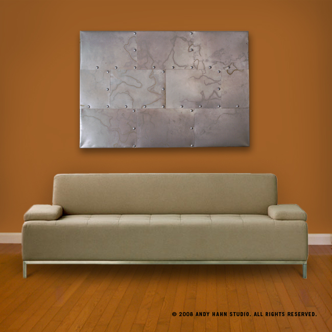 Modern metal wall art in abstract style hanging above couch.